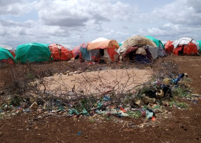"Fartun, Baidoa: ""This is a Mosque. Men from the camp pray in it. They cannot afford to buy the normal mats so they use the sand. There is no other mosque near here."""