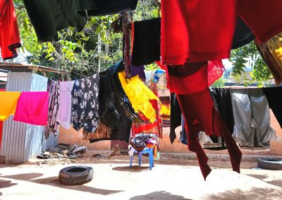"Asha, Mogadishu: ""This is me working. All those clothes you see we washed for 5.5 dollars; we washed it as two people."""