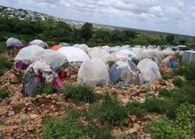 "Mumino, Baidoa: ""These buildings are called buush baariis (Rice Hut) [a hut set up by non-IDPs in order to get access to food aid]… I can't do much about it. So, I don't care as long as he is not disturbing us. I don't know whether he is really poor or not. They come from the town most of the time. I think they are looking to get free food and education for their children."""